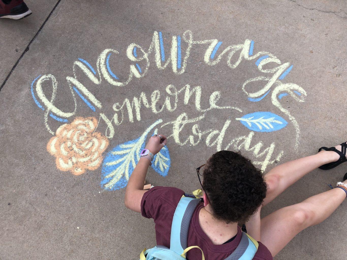 Student doing chalk art