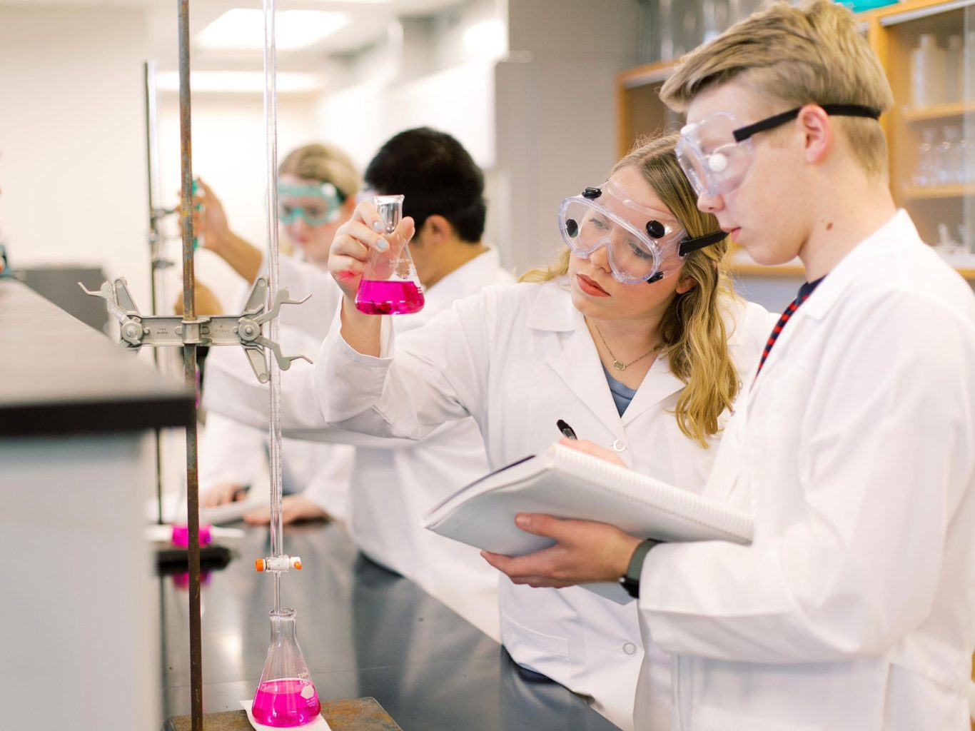 OC students in lab with beakers
