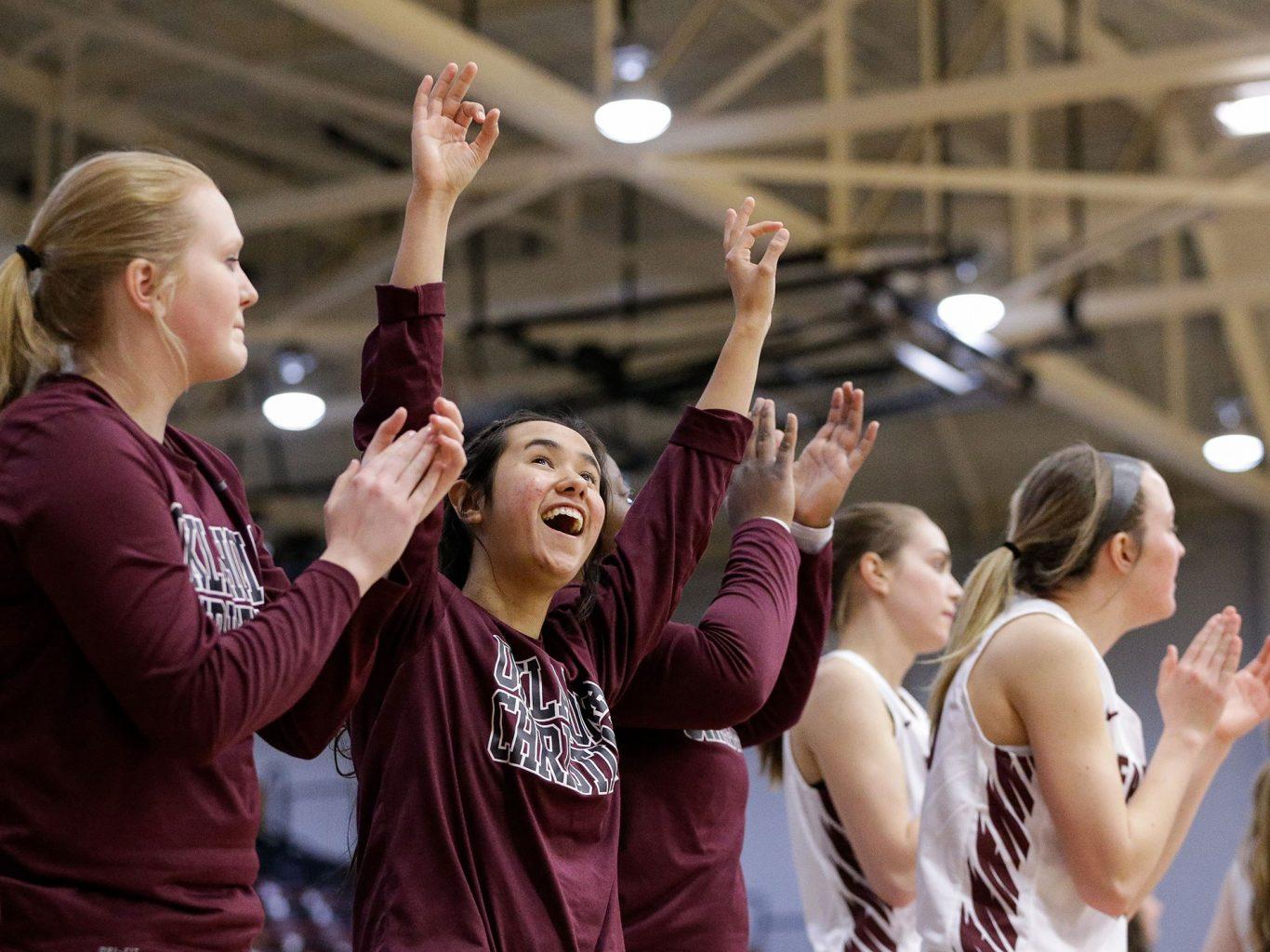 OC womens basketball team cheering