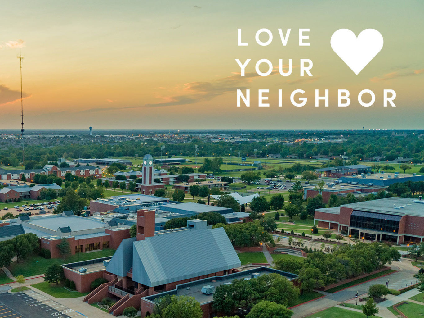 drone shot of campus with Love your neighbor title
