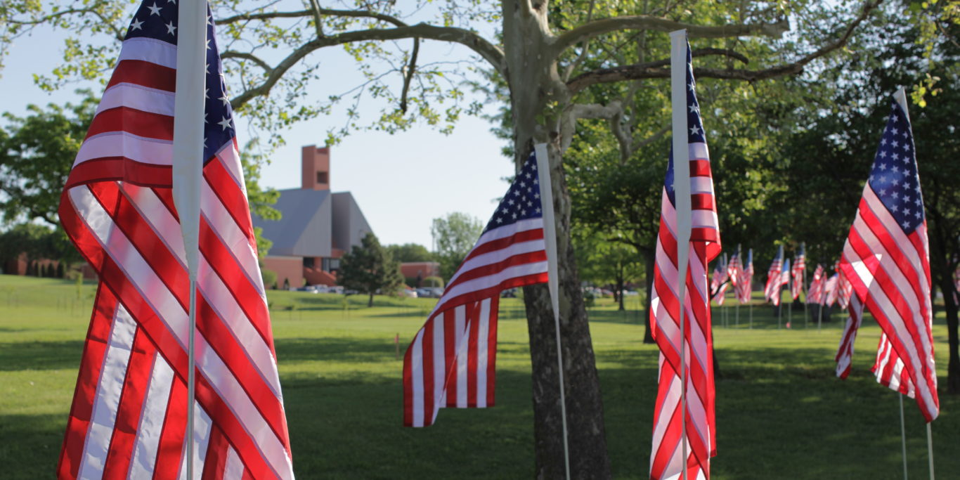 flags with Bible building