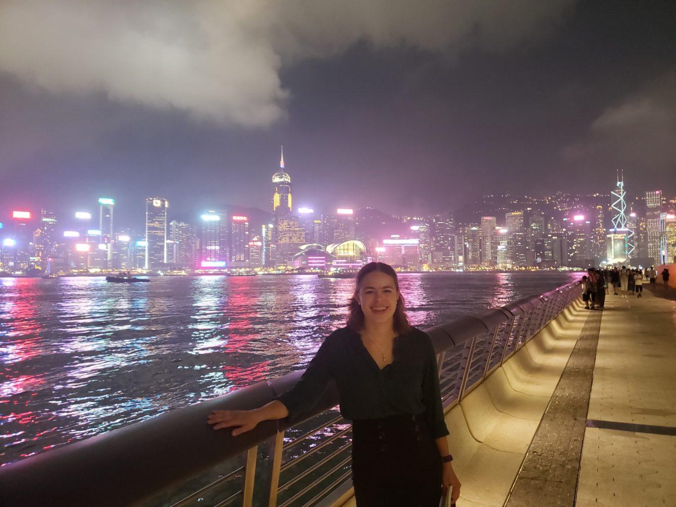 OC student and Hong Kong skyline at night