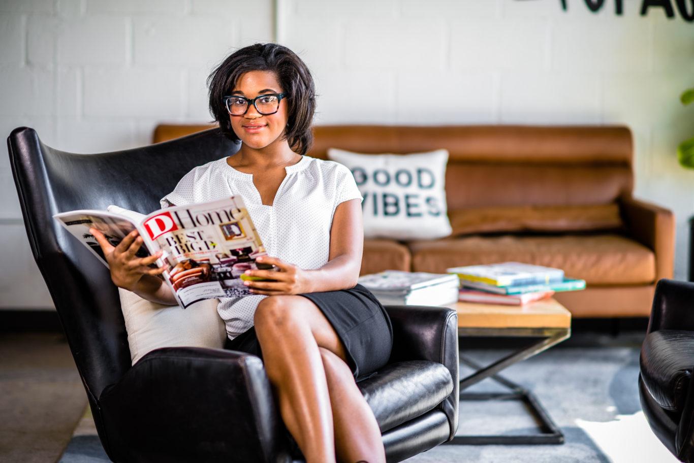 Jasmine Benton reading a magazine