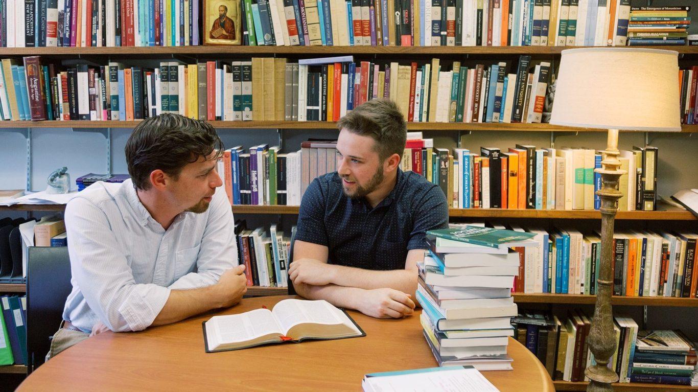OC Bible professor with student