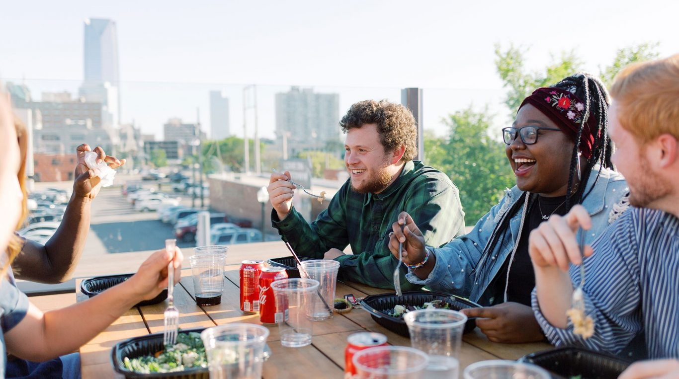 OC students eating on a rooftop deck