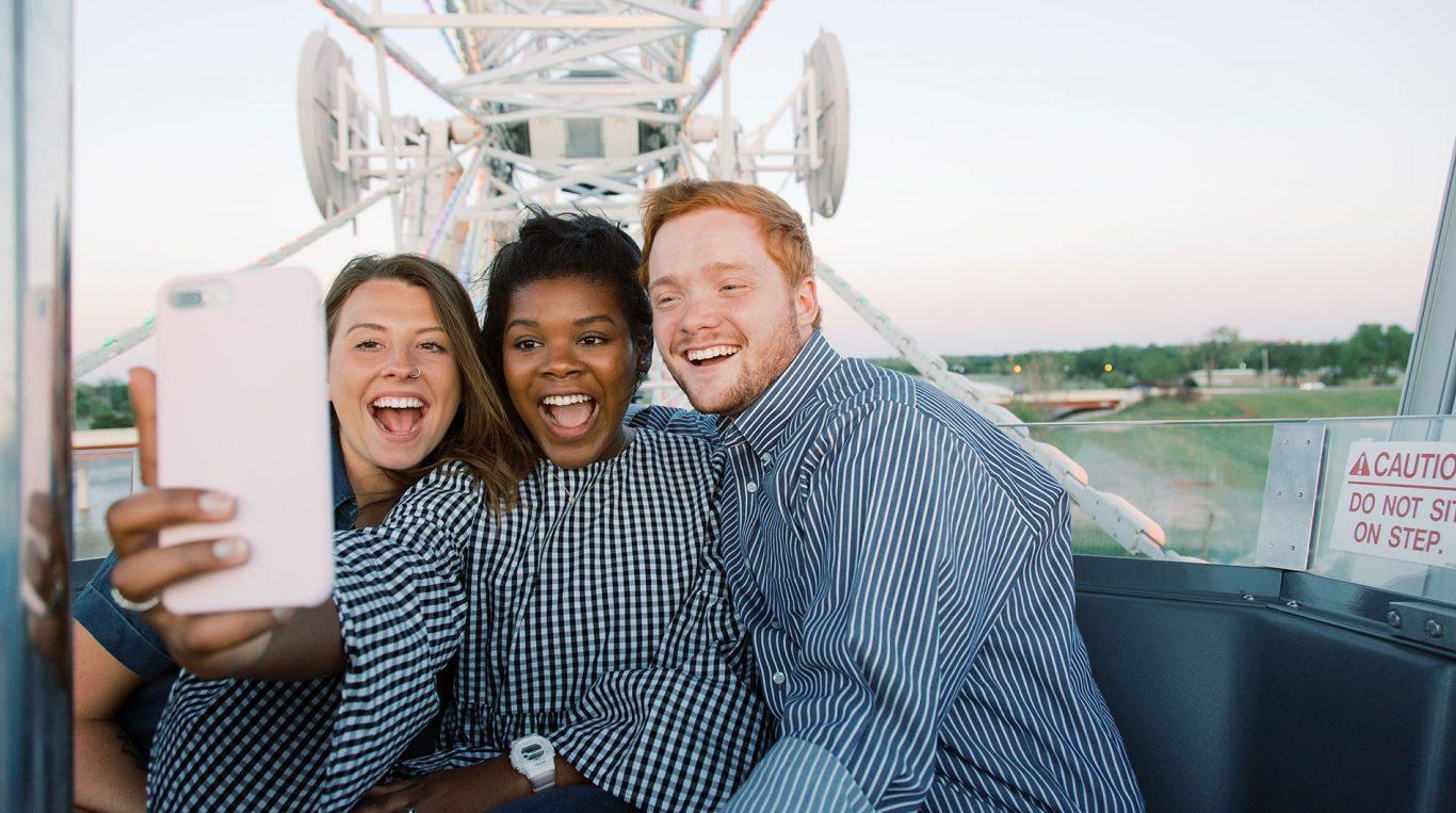 OC tudents taking a selfie on the Wheeler Ferris Wheel