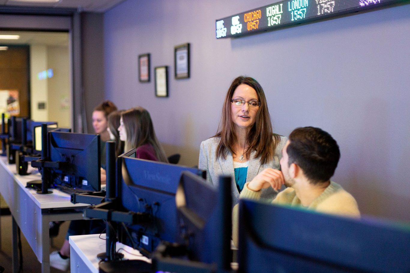 Professor and students in finance lab
