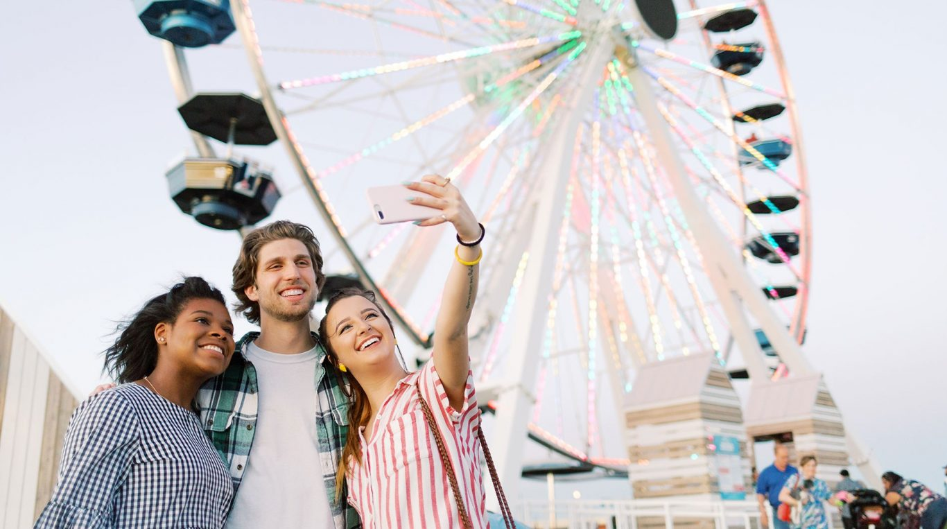 OC students taking a selfie in front of the Wheeler Ferris Wheel