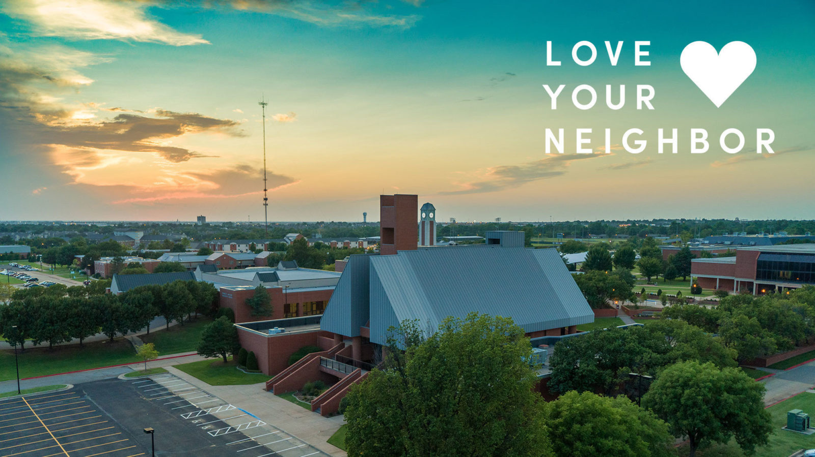 drone photo of Bible building with Love your neighbor title