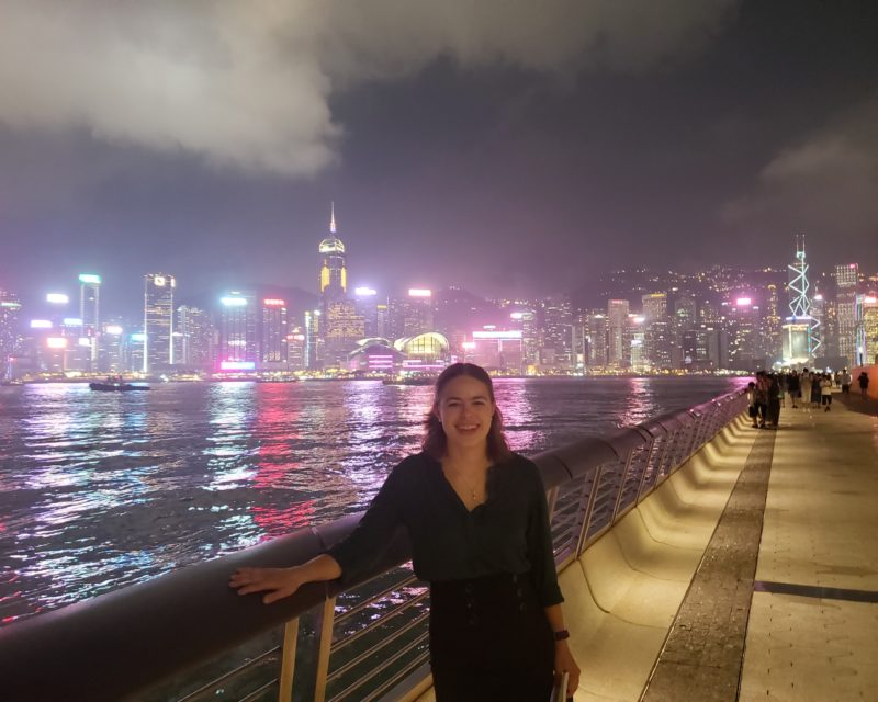 OC student and Hong Kong skyline at night