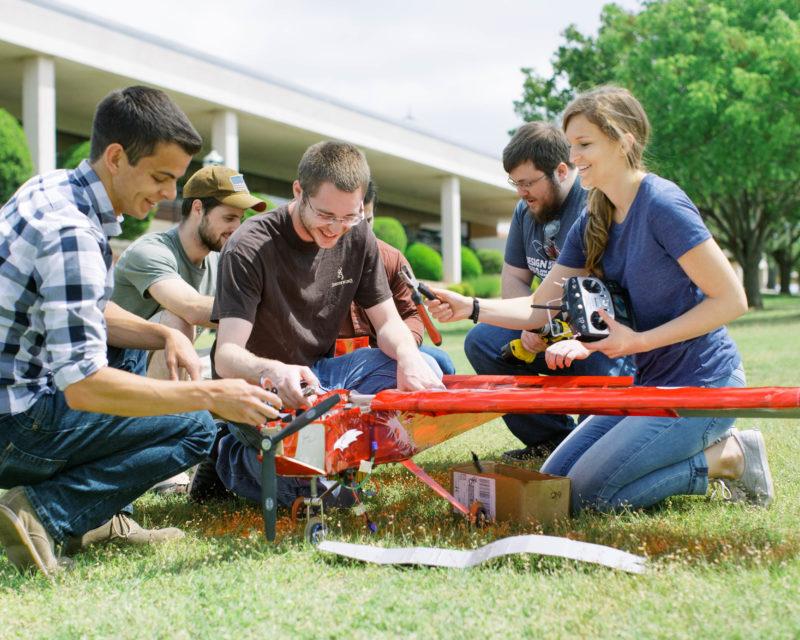 Engineering aero students building airplane