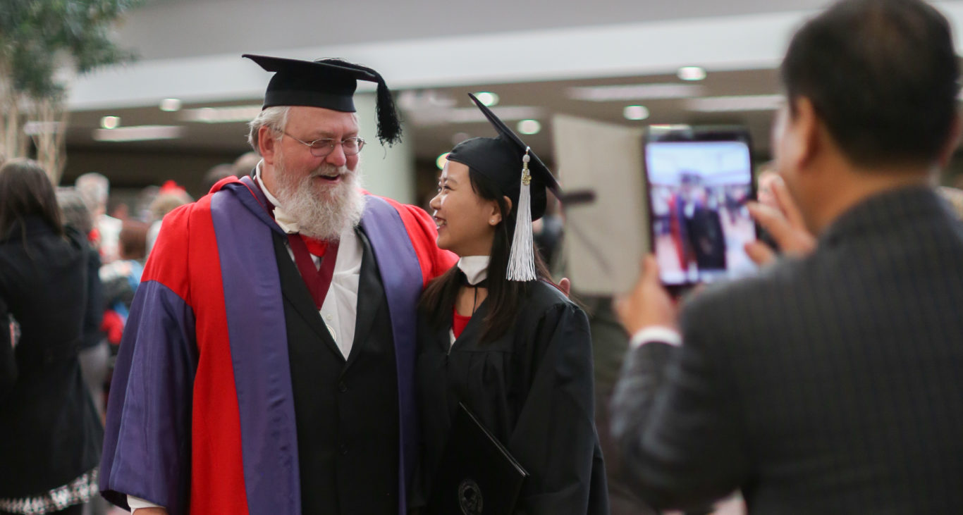 professor with student at graduation